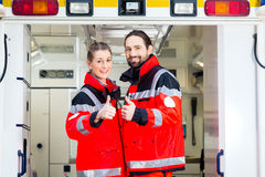 Emergency doctor in front of ambulance Stock Photos