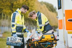 Emergency doctor giving oxygen to accident victim royalty free stock photos
