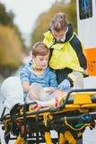 Emergency doctor giving oxygen to accident victim. A child royalty free stock photo
