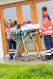 Emergency doctor home visit call radio ambulance Stock Photography