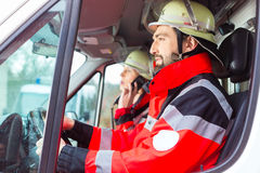 Emergency doctor and nurse driving Stock Images