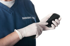 Emergency doctor or nurse uses smart phone Stock Photos