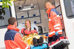 Emergency doctor with woman in ambulance Stock Photography
