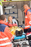 Emergency doctor with woman in ambulance Royalty Free Stock Photos