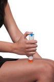 Emergency Epinephrine. Woman injecting emergency medicine into her leg Stock Photography