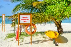 Emergency Equipment on the Beach. Emergency Equipment on a Beach with a Palm Tree in Maledives Stock Photography