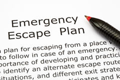 Emergency Escape Plan. With red pen royalty free stock photo