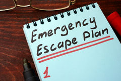Emergency Escape Plan written on a notepad. royalty free stock photos