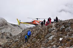 Emergency evacuation chopper helicopter for extreme weather cases at snow covered Everest Base Camp EBC, Nepal stock photo