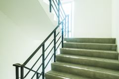 Emergency and evacuation exit stair. In the building royalty free stock images