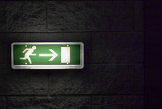 Emergency Exit. An emergency exit sign switched on Royalty Free Stock Photo
