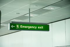 Emergency exit direction signs in a building Royalty Free Stock Photo