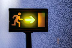 Emergency Exit light sign wallpaper background. Emergency Exit light sign, running man, wallpaper background stock photo