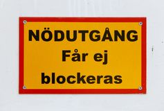 Emergency exit must not be blocked. Sign in Swedish, Emergency exit must not be blocked Royalty Free Stock Image