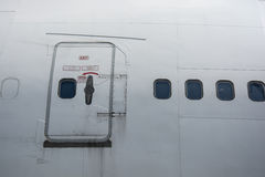 Emergency exit on the plane Royalty Free Stock Photo