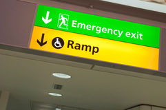 Emergency exit and ramp access sign Stock Photos