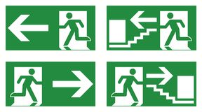 Emergency exit safety sign. White running man icon on green back. Ground - left, right and stairs version Royalty Free Stock Photo