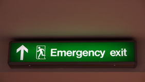 Emergency exit sign. Emergency exit sign with arrow icon (photo Royalty Free Stock Photos