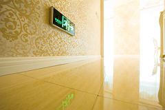 Emergency exit sign. An emergency exit sign on the wall of a modern building interior, China Stock Image