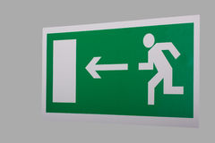 Emergency exit sign. On grey background Royalty Free Stock Photos