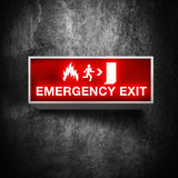 Emergency exit sign. Fire emergency exit sign on a grunge obsolete wall Royalty Free Stock Photography