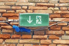 Emergency exit sign in a building Stock Photo
