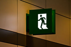 Emergency exit sign in  building Stock Images