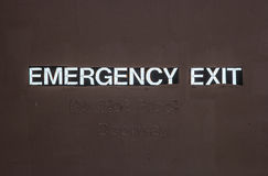 Emergency Exit Sign on a Door Royalty Free Stock Image