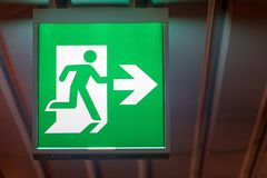 The emergency exit sign Stock Photos