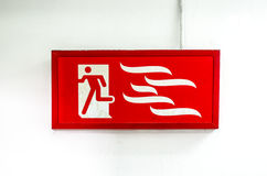 Emergency exit sign and exit door Royalty Free Stock Images