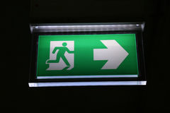 Emergency exit sign glowing in the dark Royalty Free Stock Photography
