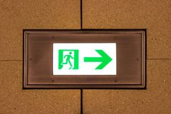 Emergency exit sign on the ground of the airport corridor intern. Ational Royalty Free Stock Images
