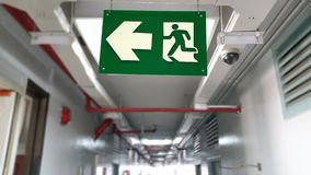 Emergency exit sign in hallway of apartment Royalty Free Stock Image