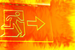emergency exit sign with hot fire color tone effect. Royalty Free Stock Photos