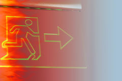 Emergency exit sign with hot fire color tone effect. Stock Images