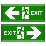 Emergency exit sign. Man running out fire exit.  Royalty Free Stock Image