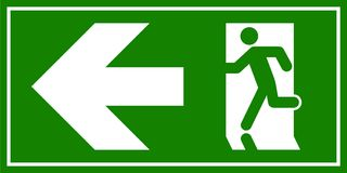 Emergency exit sign. Man running out fire exit Royalty Free Stock Photo