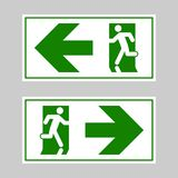 Emergency exit sign. Man running out fire exit.  Stock Image