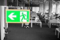 Emergency exit sign in modern offices inside an industrial plant Royalty Free Stock Photos
