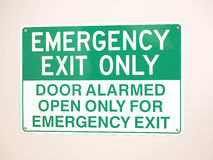 Emergency Exit sign on a wall Stock Photos