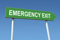 Emergency exit signpost Stock Images