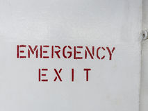 Emergency exit signpost on a ship. Royalty Free Stock Image