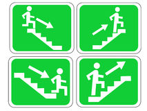 Emergency exit signs. Emergency exit sign with figure and stairs Royalty Free Stock Photo