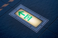 Emergency exit signs at floor fire escape Stock Photography