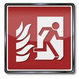 Emergency exit to the right. In case of fire exit sign and emergency exit to the right Royalty Free Stock Photos