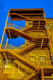 Emergency exterior stair case on side of building Stock Photos