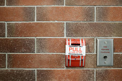 Emergency fire alarm switch on red brick wall background royalty free stock photo