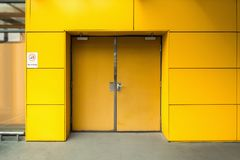 Emergency fire exit door and aluminum composite wall of warehouse.  stock images