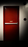 Emergency fire exit door. Emergency fire exit door and red color and white wall in building Royalty Free Stock Image