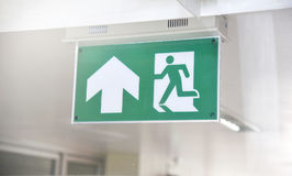 Emergency Fire Exit Sign in Green color Stock Images